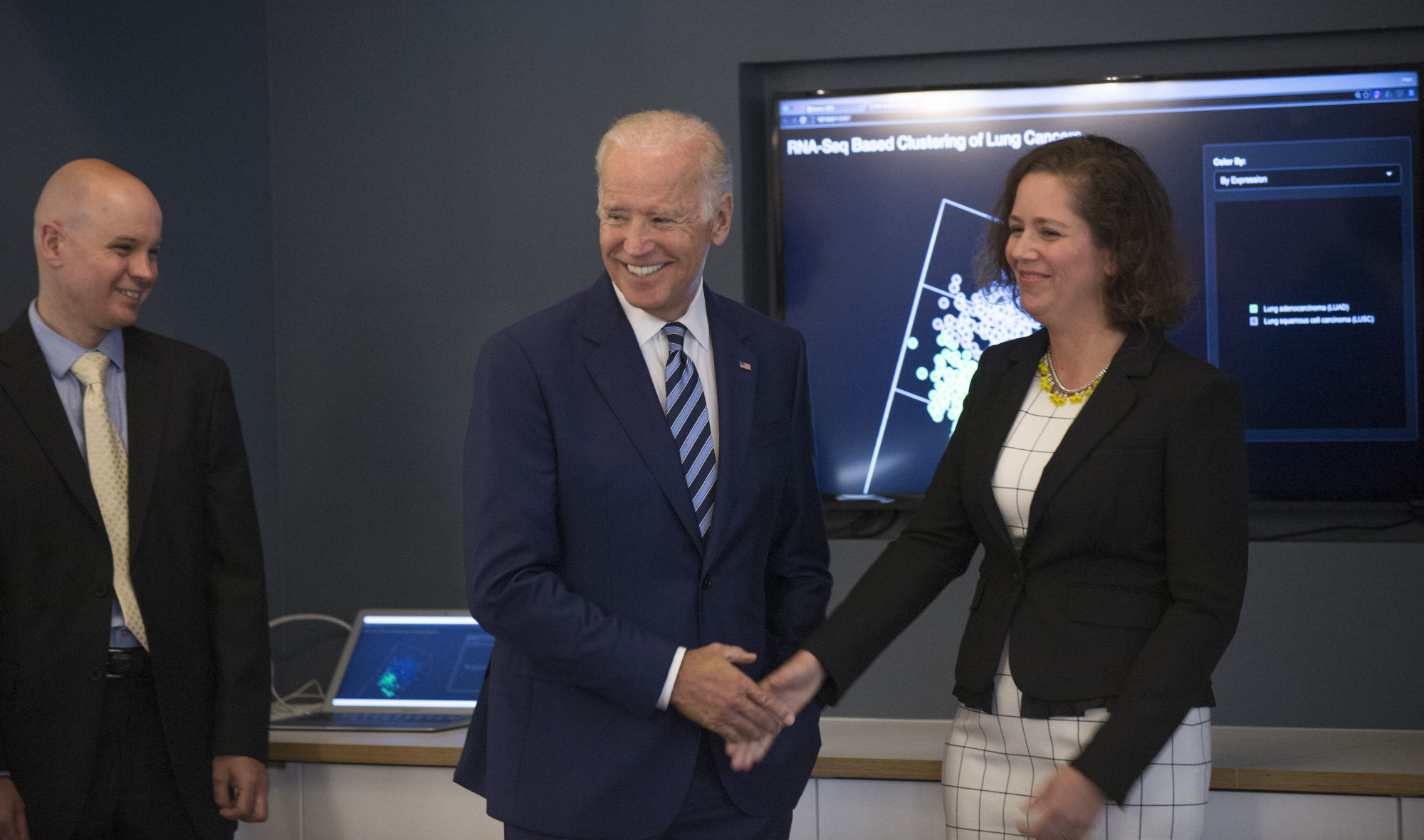 Vice President Joe Biden talks with Barbara Stranger, PhD and Piers Nash, PhD (left) during the GDC tour. (Photo by Robert Kozloff; source: Genomic Data Commons at UChicago heralds new era of data sharing for cancer research)